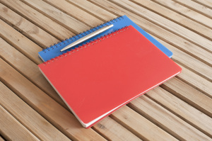 Red and blue spiral bound notebooks