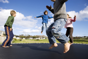 Image: Children bounce on trampoline