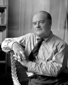 Portrait of Writer Edmund Wilson Sitting on a Wicker Chair